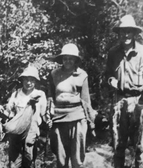 Patrick William Tierney poses with his mother, Marie, and father, John Gregory, in an undated photo from a fishing trip. (Tierney family)