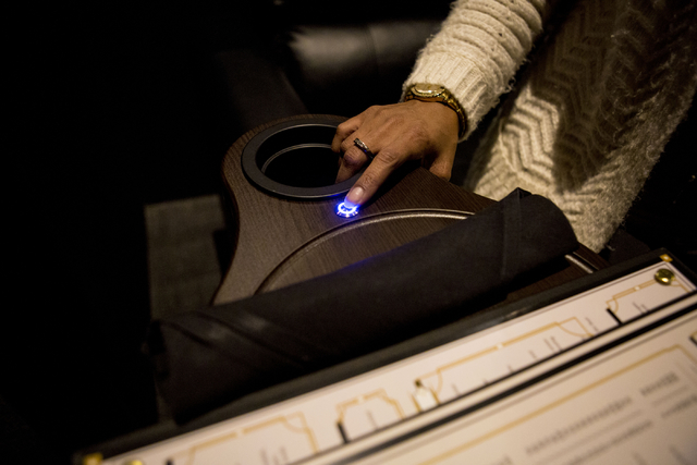 A call button to request full food and beverage service is pushed on the luxury chairs in a theatre inside of the newly opened Eclipse Theaters that has intimate theatre sizes of about 40, 814 Sou ...