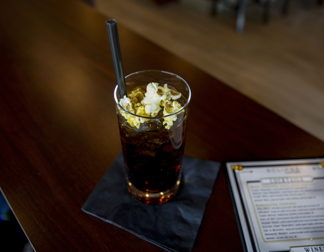 King of Pop, a butter infused rum cocktail with Pepsi and topped with popcorn is at the bar in the newly opened Eclipse Theaters that has a full bar, craft cocktails and intimate theatre sizes of  ...
