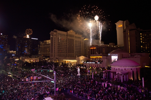Guests watch as fireworks explode during New Year's Eve festivities from the Vortex Roof Deck at The LINQ hotel-casino on the Las Vegas Strip just after midnight on Friday, Jan. 1, 2016. Daniel Cl ...