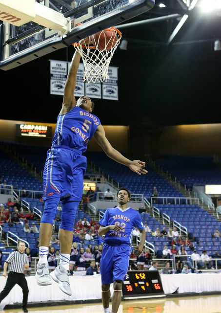 Bishop Gorman's Chuck O'Bannon dunks against Coronado during the NIAA Division I state basketball championship in Reno, Nev. on Friday, Feb. 26, 2016. Bishop Gorman won the title 83-63. (Cathleen  ...