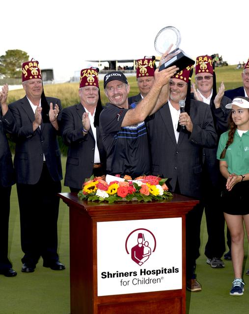 Australian Rod Pampling hoists the trophy for winning the Shriners Hospitals for Children Open at TPC Summerlin in Las Vegas Saturday, Nov. 5, 2016. Glenn Pinkerton/ Las Vegas News Bureau