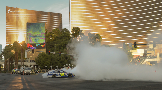 NASCAR's Jimmie Johnson performs a burnout in  his No. 48 Chevrolet SS for Hendrick Motorsports in NASCAR Champions Week Victory Lap on the Las Vegas Strip at the intersection of Spring Mountain R ...