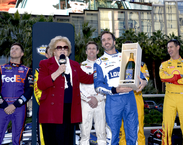 Las Vegas Mayor Carolyn G. Goodman presents Jimmie Johnson with an inscribed bottle of champagne and his photo congratulating him for 7th NASCAR Sprint Championship.  NASCARs Sprint Cup Series Cha ...