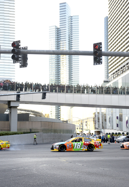 Kyle Busch joins the other NASCAR drivers as NASCARs Sprint Cup Series Champions shut down the Las Vegas Strip on Dec. 1 to take a victory lap and do burnouts on the famed boulevard as part of Cha ...