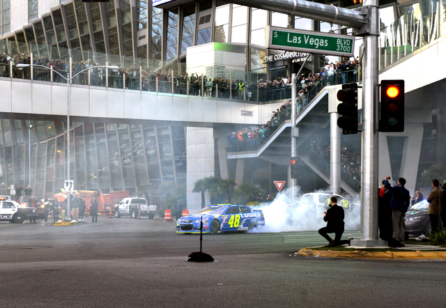 Jimmie Johnson doing brunouts as NASCARs Sprint Cup Series Champions shut down the Las Vegas Strip on Dec. 1 to take a victory lap and do burnouts on the famed boulevard as part of Champions Week  ...