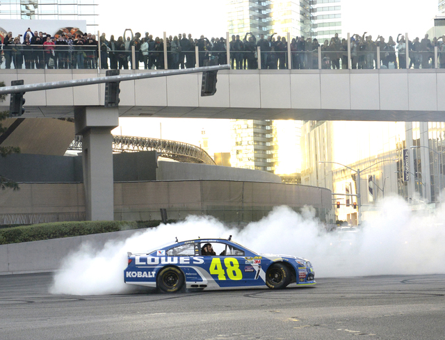 Jimmie Johnson does burnouts for thousands of fans lining the street and overhead walkways as NASCARs Sprint Cup Series Champions shut down the Las Vegas Strip on Dec. 1 to take a victory lap and  ...