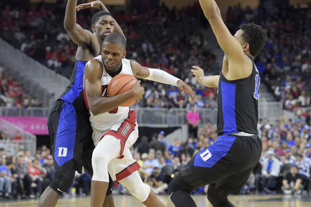 UNLV forward Tyrell Green drives between Duke forward Amile Jefferson, left, and Duke guard Frank Jackson during their NCAA basketball game Saturday, Dec. 10, 2016, at the T-Mobile Arena in Las Ve ...