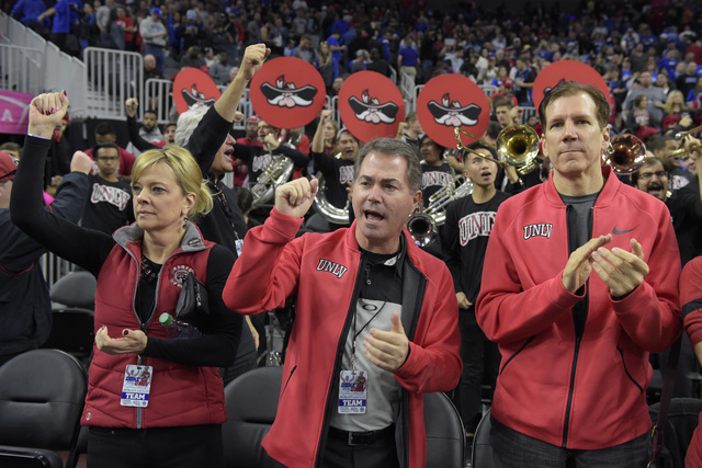 unlv president len jessup center sings the fight song during their ncaa basketball game