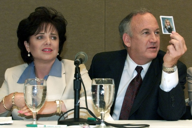 Patsy Ramsey and her husband, John Ramsey, produce a picture of Jon-Benet Ramsey during a news conference in Atlanta where they released the results of an independent lie detector test, May 24, 20 ...