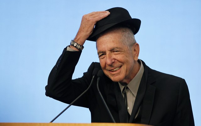 Musician Leonard Cohen tips his hat to the audience in Boston on February 26, 2012. (Jessica Rinaldi/Reuters)