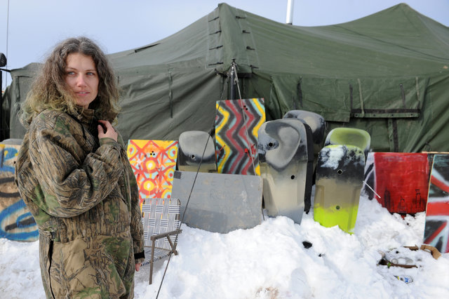 """A veteran stands in front of homemade shields in Oceti Sakowin camp as """"water protectors"""" continue to demonstrate against plans to pass the Dakota Access pipeline near the Standing Rock Indian Res ..."""
