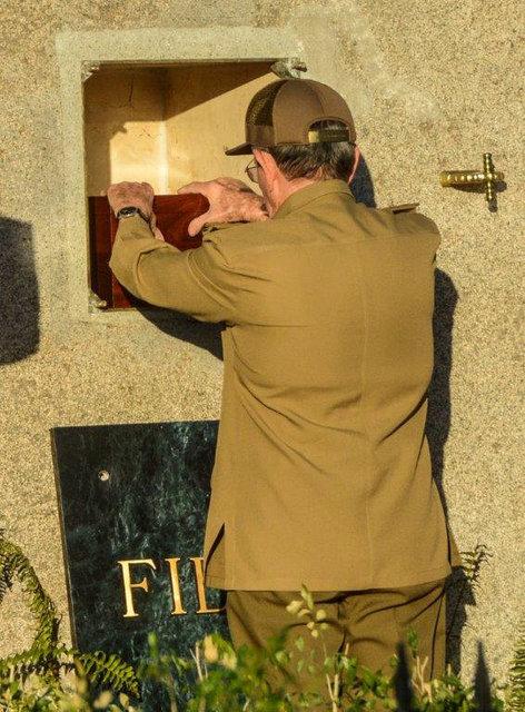 Cuba's President Raul Castro places the box containing the ashes of Cuba's former President Fidel Castro into a boulder at the Santa Ifigenia Cemetery, in Santiago de Cuba, December 4, 2016. (Marc ...