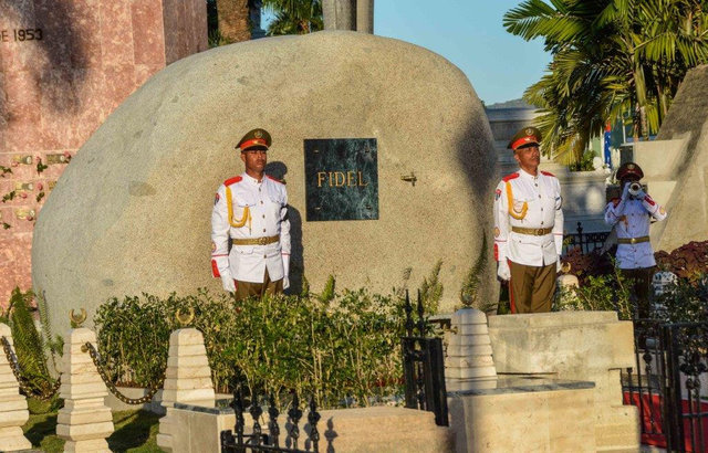 Soldiers stand guard next to a boulder where the ashes of Cuba's former President Fidel Castro were placed by his brother President Raul Castro (not pictured) at the Santa Ifigenia Cemetery, in Sa ...