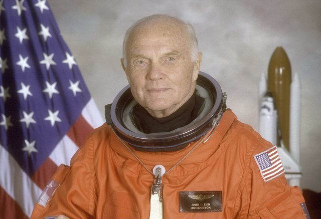 STS-95 crewmember, astronaut and U.S. Sen. John Glenn poses for his official NASA photo taken April 14, 1998. Glenn was the first American to orbit the earth and returned to space in 1998 aboard t ...