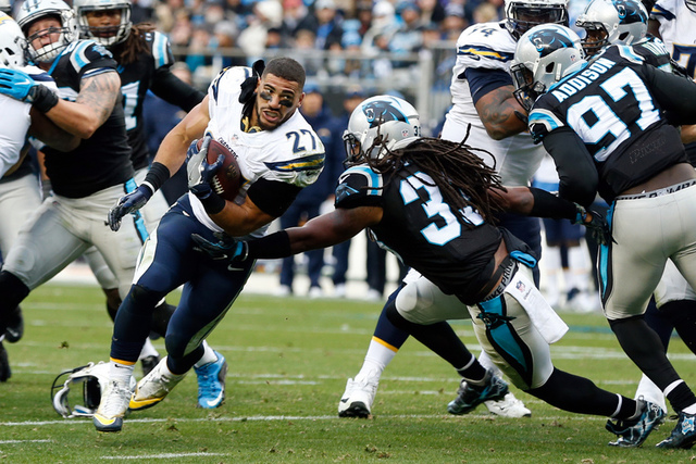 Dec 11, 2016; Charlotte, NC, USA; San Diego Chargers running back Kenneth Farrow (27) runs after losing his helmet in the third quarter against the Carolina Panthers at Bank of America Stadium. Th ...