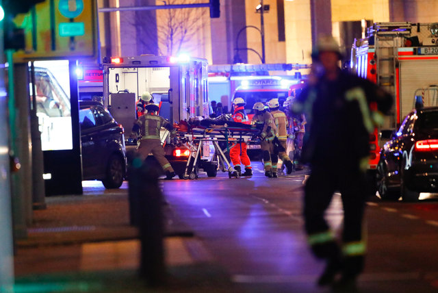 Paramedics work at the site of an accident at a Christmas market on Breitscheidplatz square near the fashionable Kurfuerstendamm avenue in the west of Berlin, Germany, December 19, 2016. (Fabrizio ...