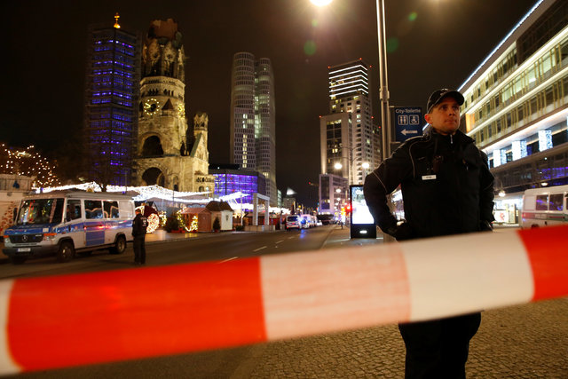 Police secures the area at the site of an accident at a Christmas market on Breitscheidplatz square near the fashionable Kurfuerstendamm avenue in the west of Berlin, Germany, December 19, 2016. ( ...