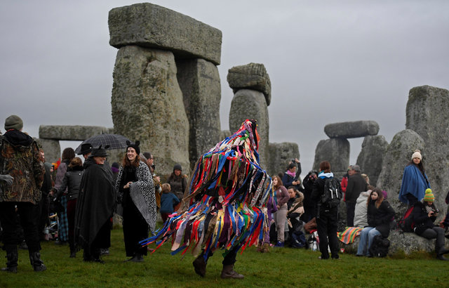 Visitors and revellers celebrate the winter solstice at the prehistoric stones of the Stonehenge monument near Amesbury in south west Britain, December 21, 2016. (Toby Melville/Reuters)