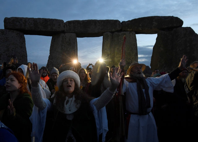 Visitors and revellers gather at the prehistoric stones of the Stonehenge monument at dawn on Winter Solstice, the shortest day of the year, near Amesbury in south west Britain, December 21, 2016. ...