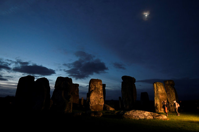 Visitors take photos amongst the prehistoric stones of the Stonehenge monument at dawn on Winter Solstice, the shortest day of the year, near Amesbury in south west Britain, December 21, 2016. (To ...