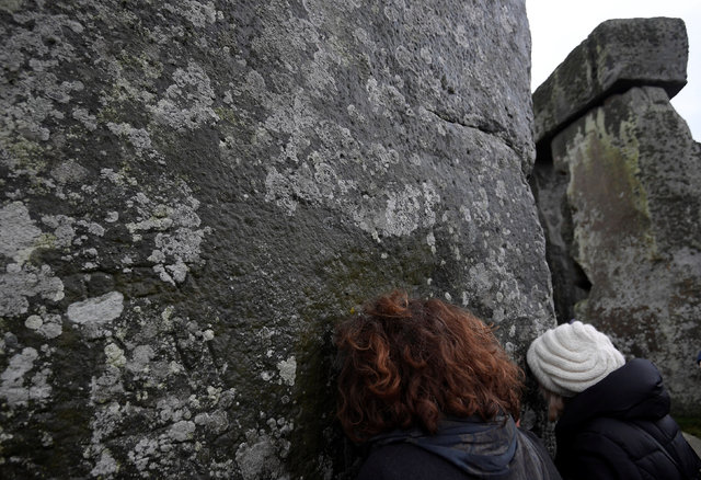 Visitors react amongst the prehistoric stones of the Stonehenge monument at dawn on Winter Solstice, the shortest day of the year, near Amesbury in south west Britain, December 21, 2016. (Toby Mel ...