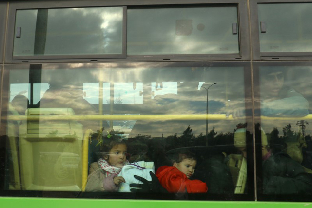 Evacuees from rebel-held eastern Aleppo arrive by bus to an area on the western edge of Aleppo city. (Ammar Abdullah/Reuters)