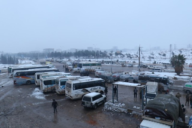 A general view shows parked busses at insurgent-held al-Rashideen, Syria December 21, 2016. (Ammar Abdullah/Reuters)