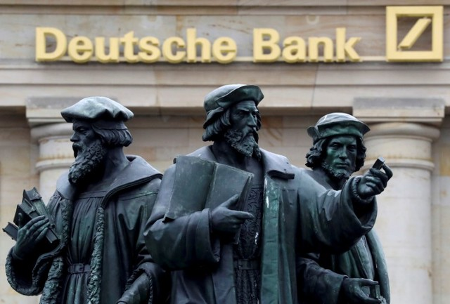 A statue is pictured next to the logo of Germany's Deutsche Bank in Frankfurt, Germany September 30, 2016. (Kai Pfaffenbach/File, Reuters)