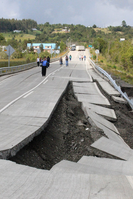 A damaged road is seen after a quake at Chadmo, on Chiloe island, southern Chile, December 25, 2016. REUTERS/Alvaro Vidal EDITORIAL USE ONLY. NO RESALES.