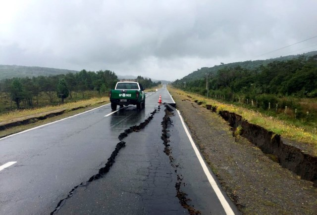 A damaged road is seen after a quake hit Chiloe island, southern Chile, December 25, 2016. REUTERS/Stringer