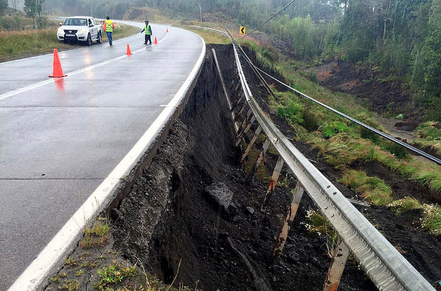 A damaged road is seen after a quake hit Chiloe island, southern Chile, December 25, 2016. REUTERS/Stringer EDITORIAL USE ONLY. NO RESALES. NO ARCHIVE. CHILE OUT. NO COMMERCIAL OR EDITORIAL SALES  ...