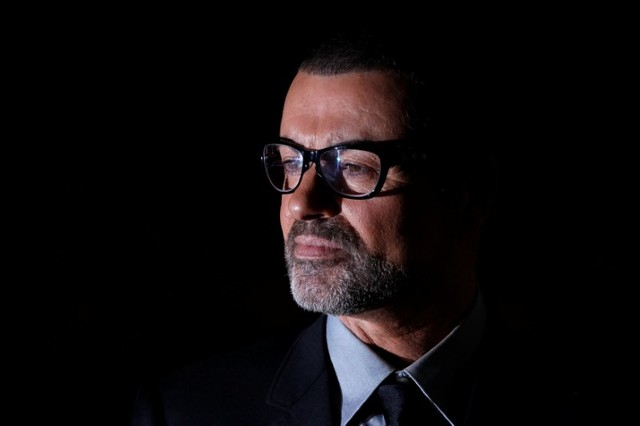 FILE PHOTO British singer George Michael poses for photographers before a news conference at the Royal Opera House in central London May 11, 2011.   REUTERS/Stefan Wermuth/File Photo