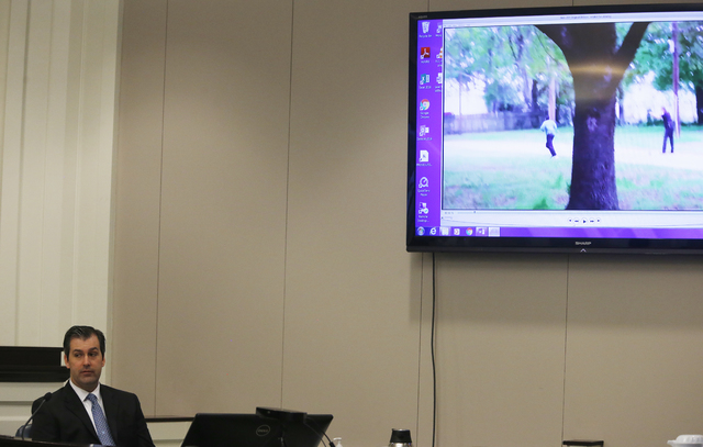 Former North Charleston police officer Michael Slager,looks away from a video monitor as he testifies during his murder trial at the Charleston County court in Charleston, S.C., Tuesday, Nov. 29,  ...