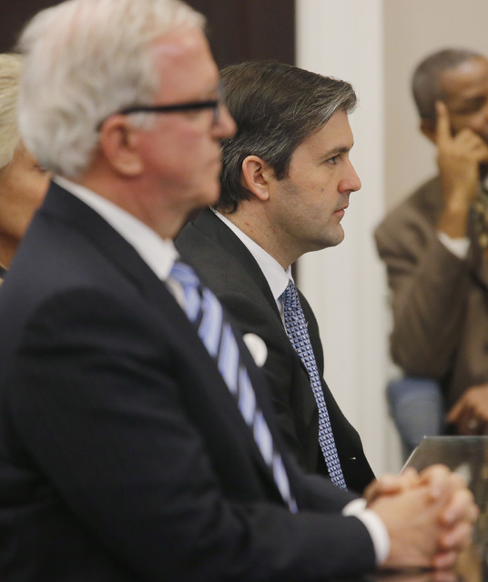 North Charleston police officer Michael Slager, right, sits in the courtroom during his murder trial at the Charleston County court in Charleston, S.C., Friday, Dec. 2, 2016, in Charleston, S.C. ( ...