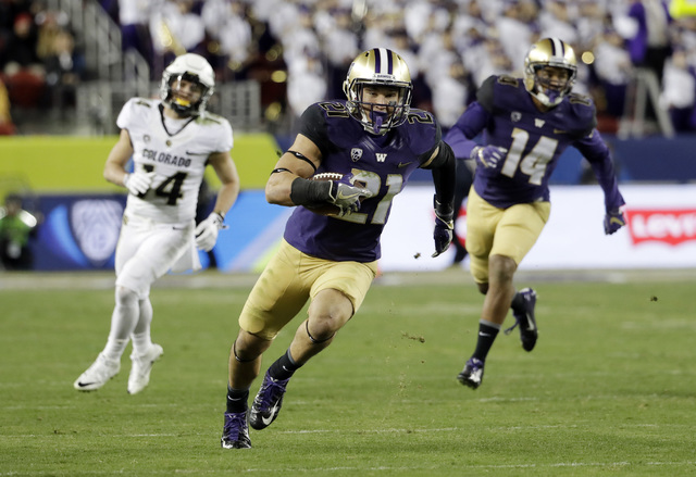 Washington defensive back Taylor Rapp (21) runs after intercepting a Colorado pass during the second half of the Pac-12 Conference championship NCAA college football game Friday, Dec. 2, 2016, in  ...