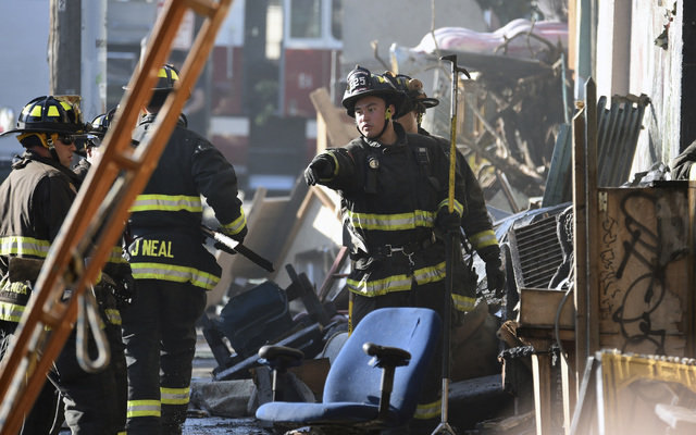 Firefighters assess the scene where a deadly fire tore through a late-night electronic music party in a warehouse in Oakland, Calif., Saturday, Dec. 3, 2016. (Josh Edelson/AP)