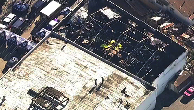 This Dec. 3, 2016 still frame from video provided by KGO-TV shows the Ghost Ship Warehouse after a fire swept that started late Friday swept through the Oakland, Calif., building, killing dozens.  ...