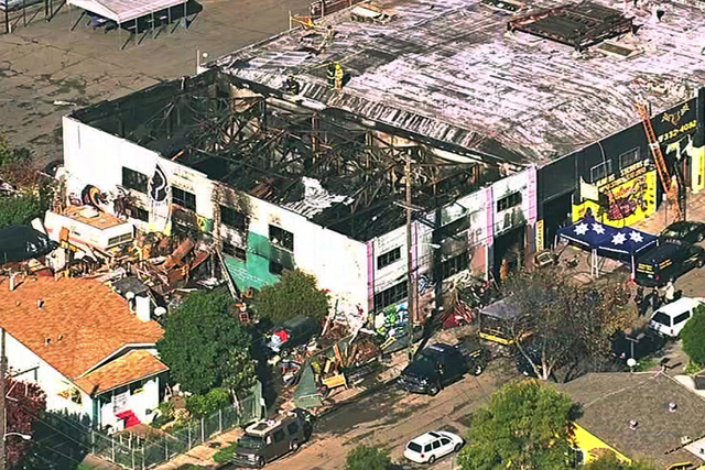 This Dec. 3, 2016 image from video provided by KGO-TV shows the Ghost Ship Warehouse after a fire that started late Friday swept through the Oakland, Calif., building. (KGO-TV via AP)