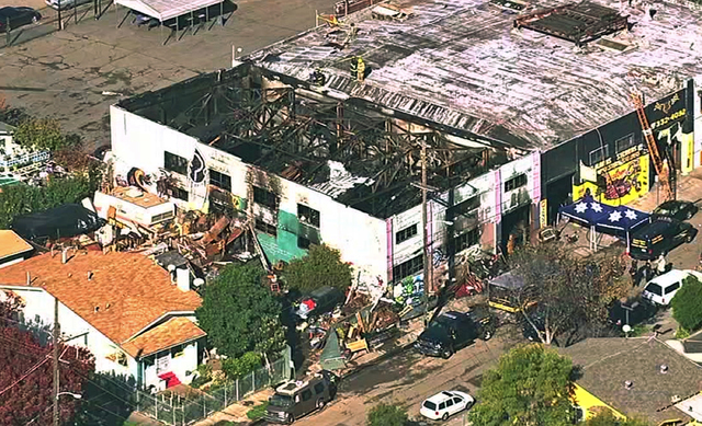This Dec. 3, 2016 image from video provided by KGO-TV shows the Ghost Ship Warehouse after a fire that started late Friday swept through the Oakland, Calif., building, killing dozens. (KGO-TV via AP)