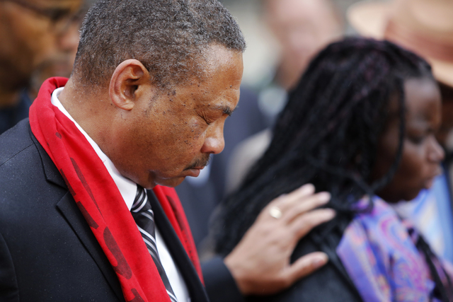 Pastor Thomas Dixon, left, prays during a prayer vigil in front of the Charleston County Courthouse as the jury deliberates in the Michael Slager trial Monday, Dec. 5, 2016, in Charleston, S.C. (M ...