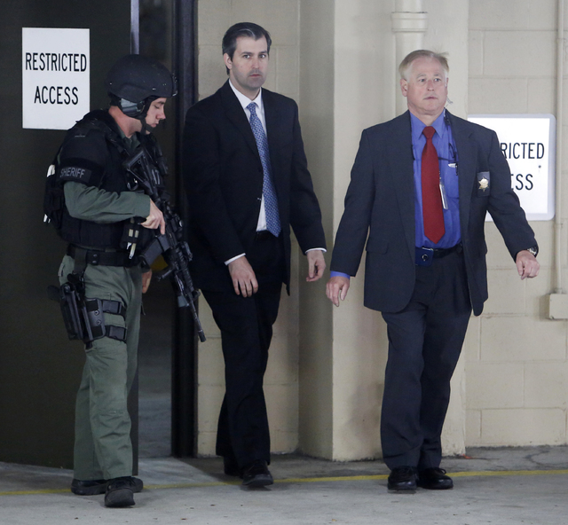 Michael Slager, center, walks from the Charleston County Courthouse under the protection from the Charleston County Sheriff's Department during a break in the jury deliberations in his trial Monda ...