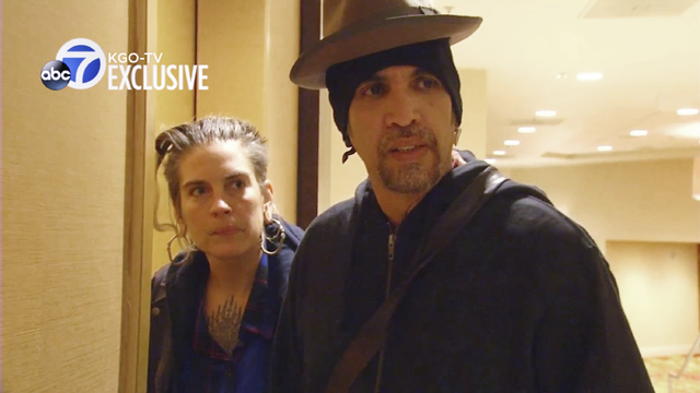 This still frame from exclusive video provided by San Francisco TV station KGO-TV, made late Sunday, Dec. 4, 2016, shows Derick Ion Almena, right, and Micah Allison, the couple who operated the Gh ...