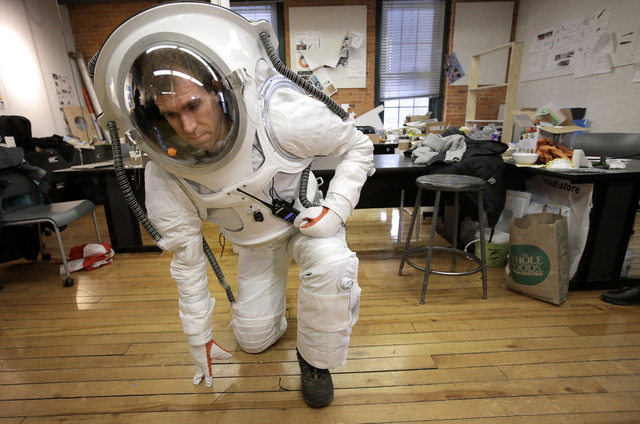 Andrzej Stewart, the chief engineering officer on a year-long Mars simulation mission that ended in August, tests the flexibility of a new space suit the Rhode Island School of Design (RISD) creat ...