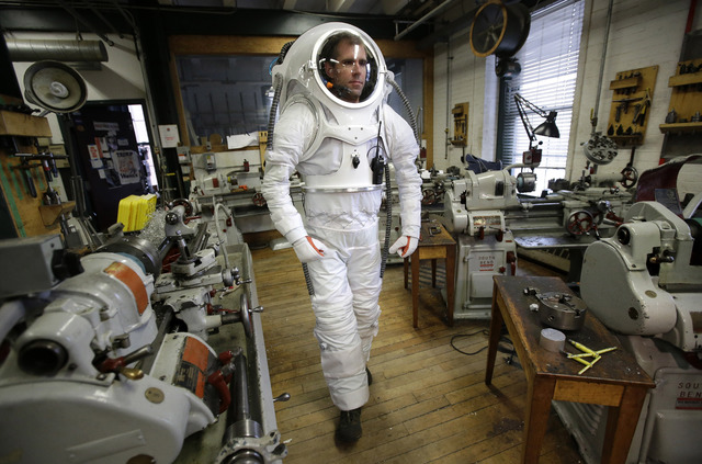 Andrzej Stewart, the chief engineering officer on a year-long Mars simulation mission that ended in August, walks through a machine shop at the Rhode Island School of Design (RISD), while wearing  ...
