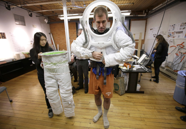 Erica Kim, left, an industrial and apparel design student at the Rhode Island School of Design (RISD), helps Andrzej Stewart, the chief engineering officer on a year-long Mars simulation mission t ...
