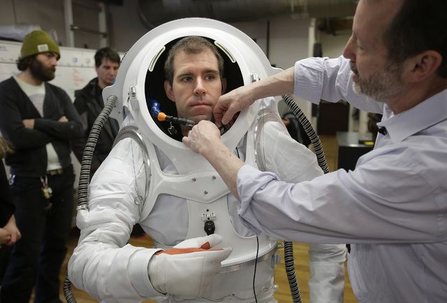 Michael Lye, a Rhode Island School of Design (RISD) faculty member, right, helps Andrzej Stewart, who was the chief engineering officer on a year-long Mars simulation mission that ended in August, ...
