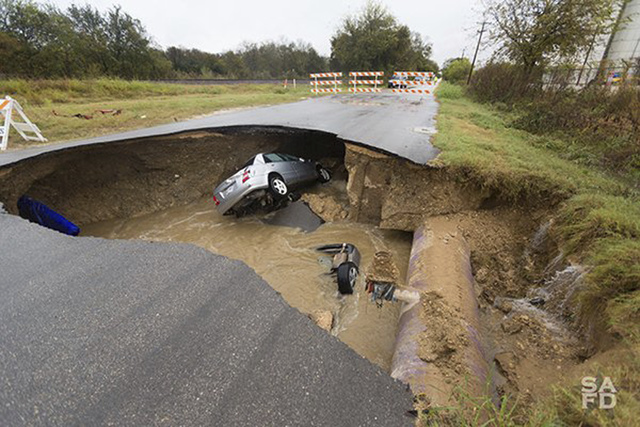 Officials say a Bexar County Sheriff's Deputy Dora Linda Nishihara an off-duty sheriff's deputy died and others were injured when two vehicles plunged into a water-filled sinkhole. Utility officia ...