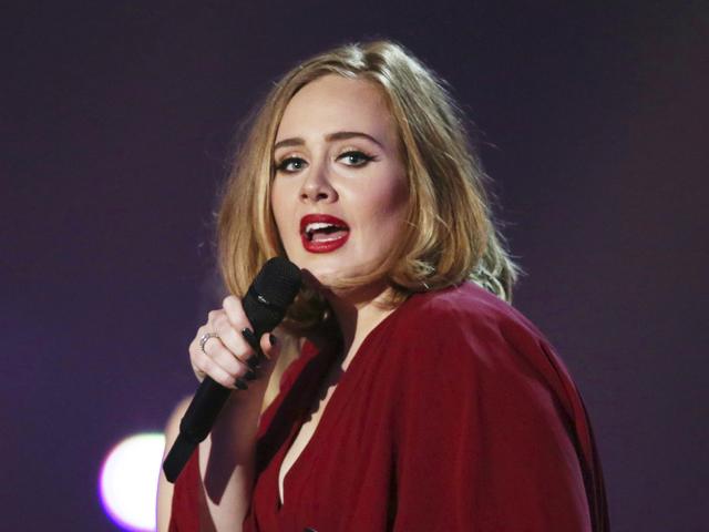 Adele performs at the Brit Awards 2016 at the 02 Arena in London, Feb. 24, 2016. (Joel Ryan/Invision/AP)