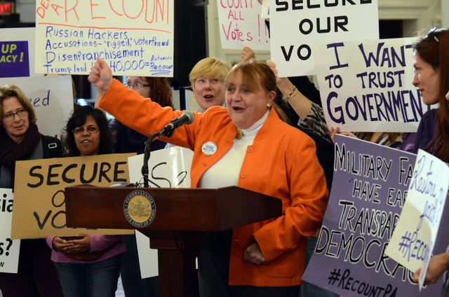 Marybeth Kuznik, center, of VotePA, an election integrity advocacy group, leads a rally at the Pennsylvania Capitol in support of a Green Party-backed quest for a recount of Pennsylvania's Nov. 8  ...